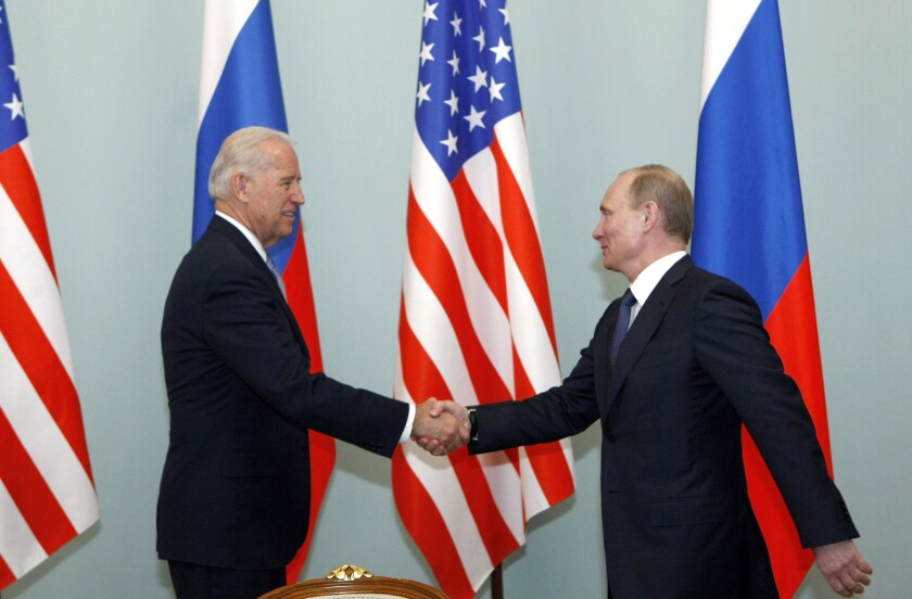 FILE - In this March 10, 2011 file photo, then U.S. Vice President Joe Biden, left, shakes hands with Russian Prime Minister Vladimir Putin in Moscow. Biden likes to say foreign policy is about building personal relationships. But unlike his three most recent White House predecessors, who all tried and failed to build a rapport with Vladimir Putin, Biden over the years in public and private comments has demonstrated that the virtue of personal diplomacy might have its limits when it comes to the Russian leader. (AP Photo/Alexander Zemlianichenko)
