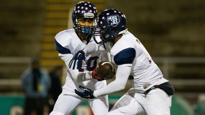 Horizon Christian's Thomas Marcus hands off to DeAndre Daniels in last year's Division V title game. Marcus now plays for San Diego. Daniels plays for St. Augustine.