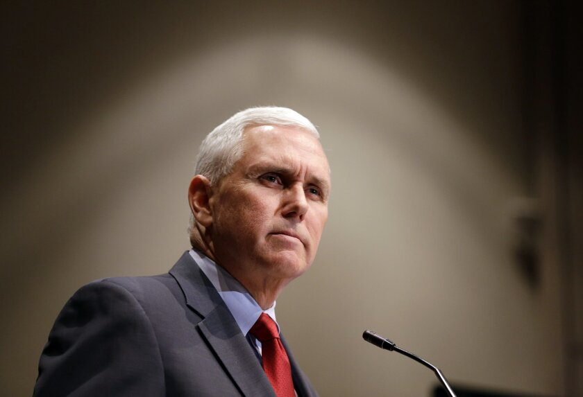 """FILE - In this Tuesday, Jan. 27, 2015 file photo, Indiana Gov. Mike Pence announces that the Centers for Medicaid and Medicare Services has approved the state's waiver request for the plan his administration calls HIP 2.0, during a speech in Indianapolis. Pence said Wednesday that he regrets the """"c"""