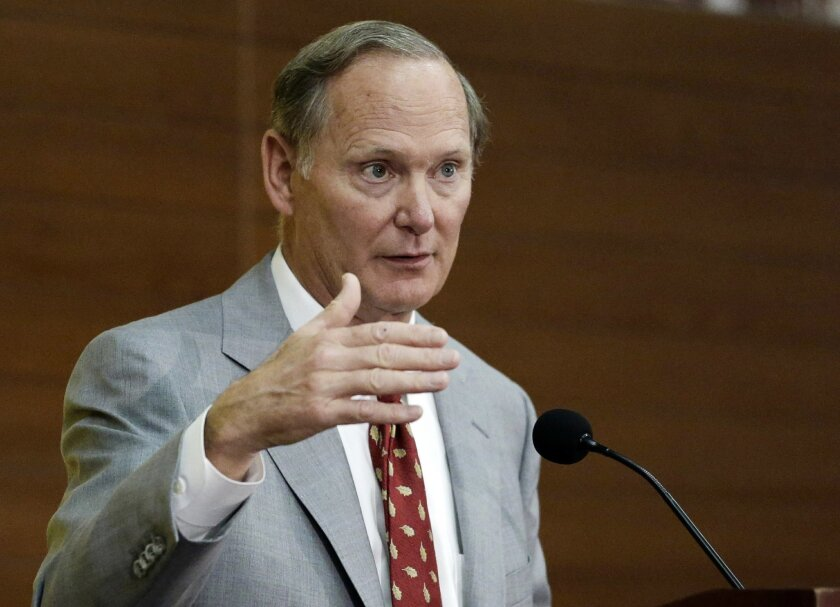 FILE - In this Dec. 3, 2013, file photo, University of Southern California athletic director Pat Haden speaks during a news conference in Los Angeles. Haden was taken to his doctor after becoming faint in his office on campus Wednesday, Feb. 10, 2016. Sports information director Tim Tessalone says