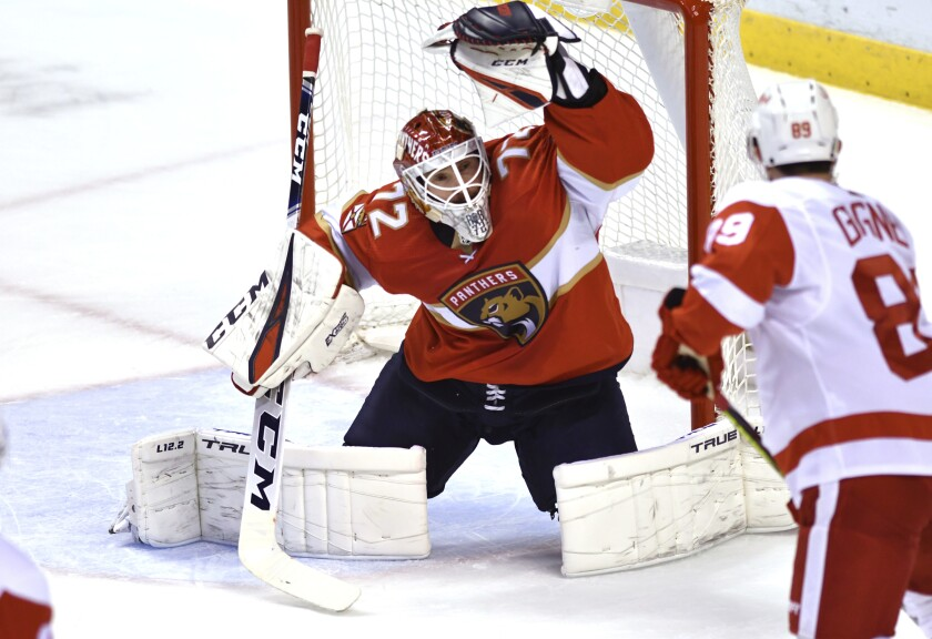 Florida Panthers goaltender Sergei Bobrovsky (72) makes a save on a shot by Detroit Red Wings center Sam Gagner (89) during the first period of an NHL hockey game Tuesday, Feb. 9, 2021, in Sunrise, Fla. (AP Photo/Jim Rassol)