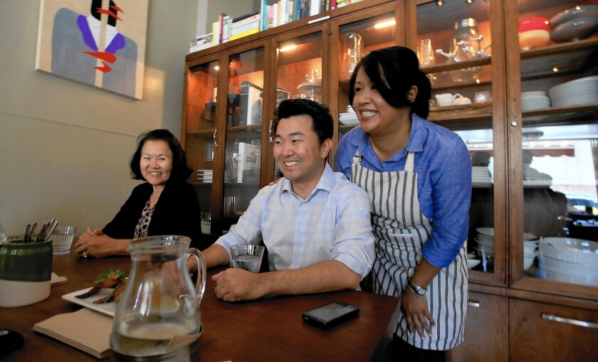 L.A. City Councilman-elect David Ryu celebrates his election victory with his mother, Michelle, left, and restaurant owner Jennyfer Rodgers at Epicurean Umbrella in Los Feliz. Ryu ran on the idea that the status quo is not working at City Hall.