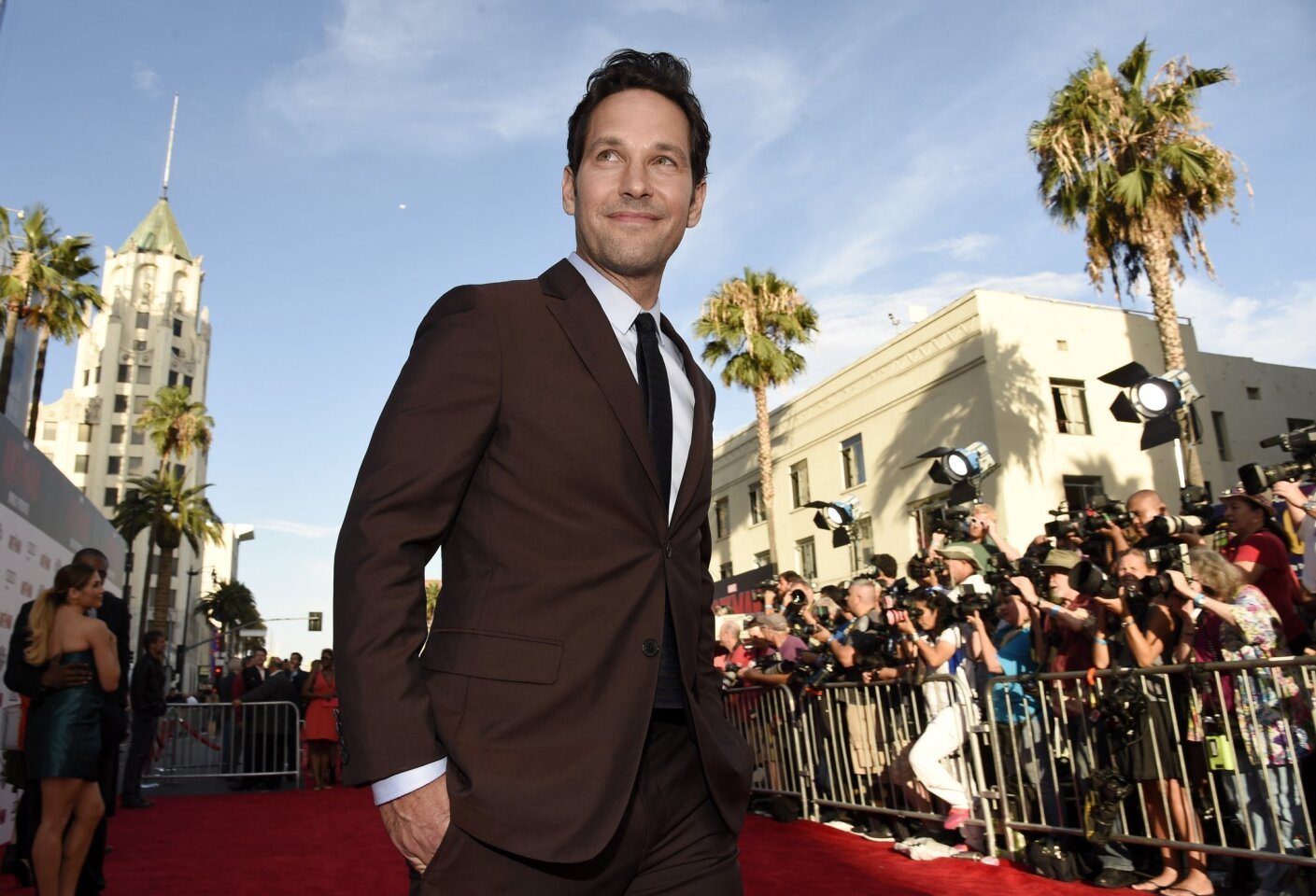 "Paul Rudd, star of ""Ant-Man,"" walks the red carpet at the premiere of the film."