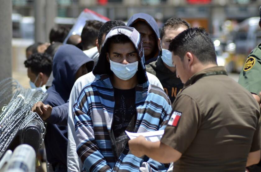 Judge reinstates nationwide halt on Trump asylum policy plan