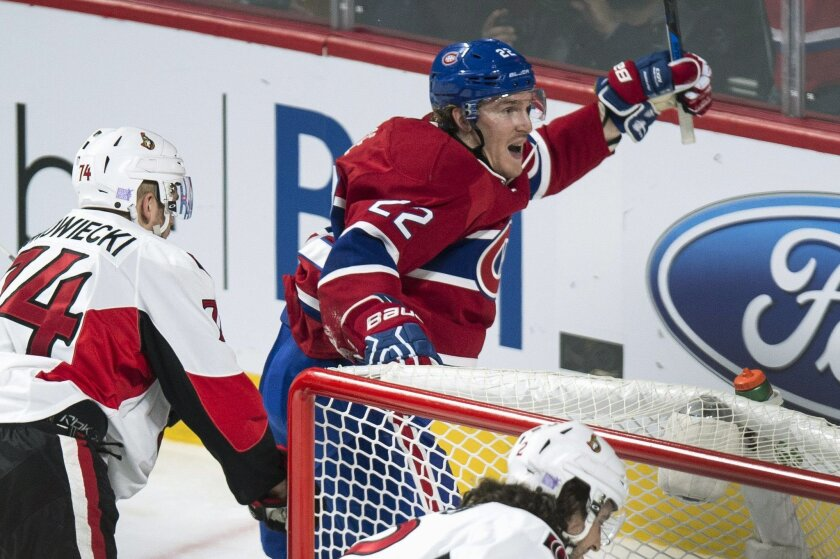 Montreal Canadiens' Dale Weise, right, celebrates his power-play goal against the Ottawa Senators during the second period of an NHL hockey game Tuesday, Nov. 3, 2015, in Montreal. (Paul Chiasson/The Canadian Press via AP)