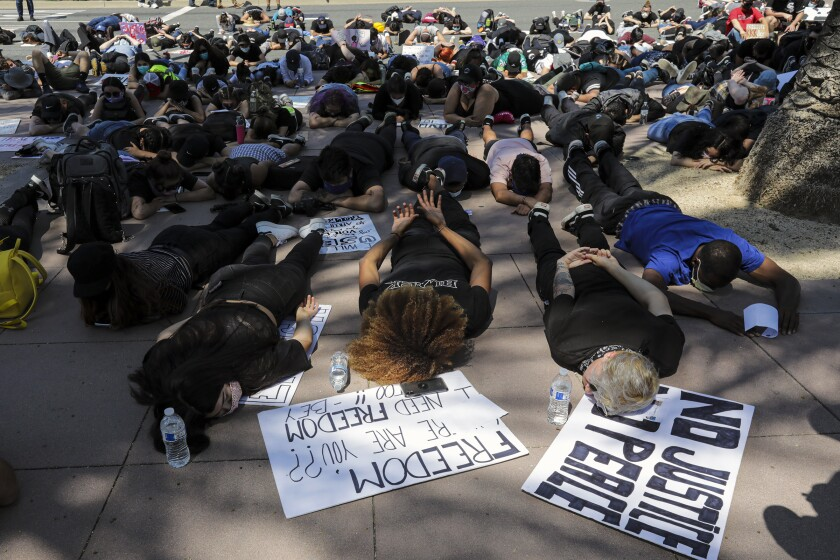 Protesters stage a sit-in demonstration at the Anaheim Civic Center