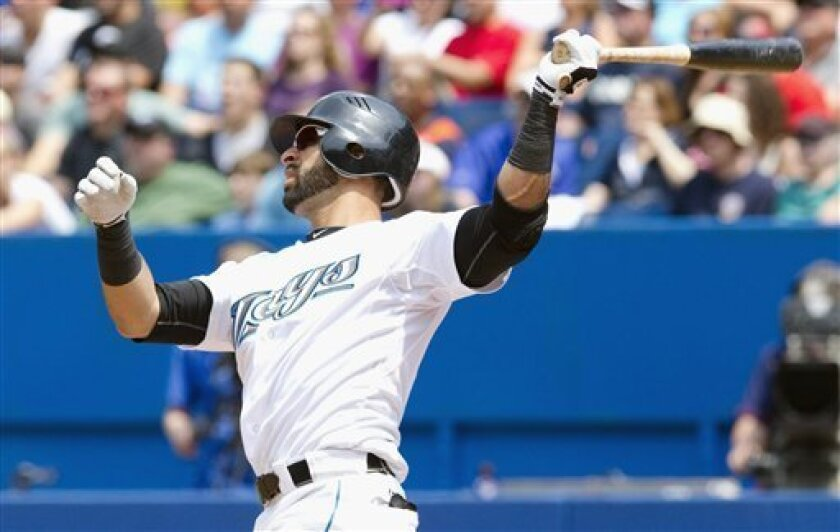 Toronto Blue Jays' Jose Bautista hits a solo home run against the Philadelphia Phillies during the fourth inning of an interleague baseball game in Toronto Saturday, July 2, 2011. (AP Photo/The Canadian Press, Darren Calabrese)