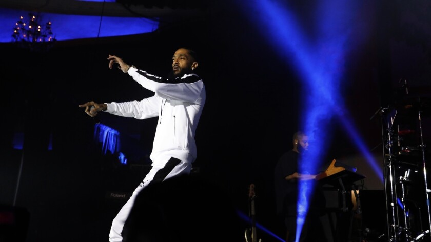 """Rapper Nipsey Hussle performs work from his Grammy-nominated album """"Victory Lap"""" at the Palladium in Hollywood in 2018."""