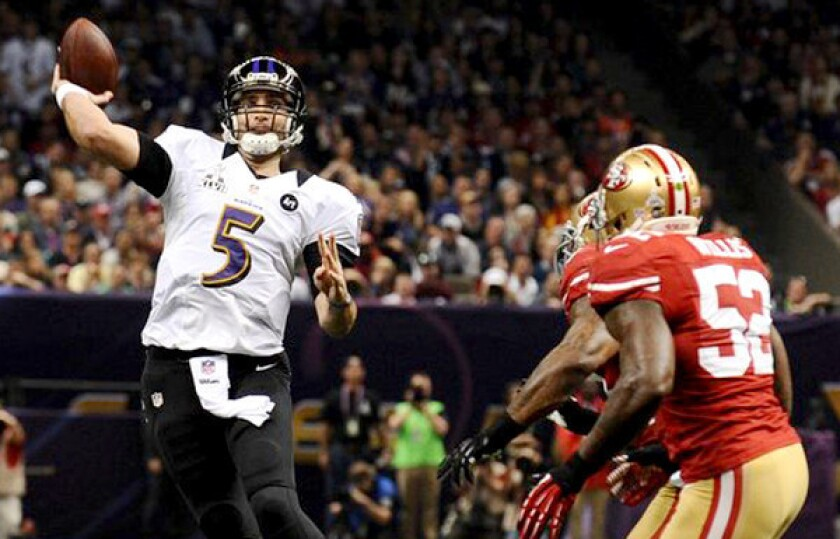 Ravens quarterback Joe Flacco passes under pressure from 49ers linebacker Patrick Willis in the first quarter of the Super Bowl.