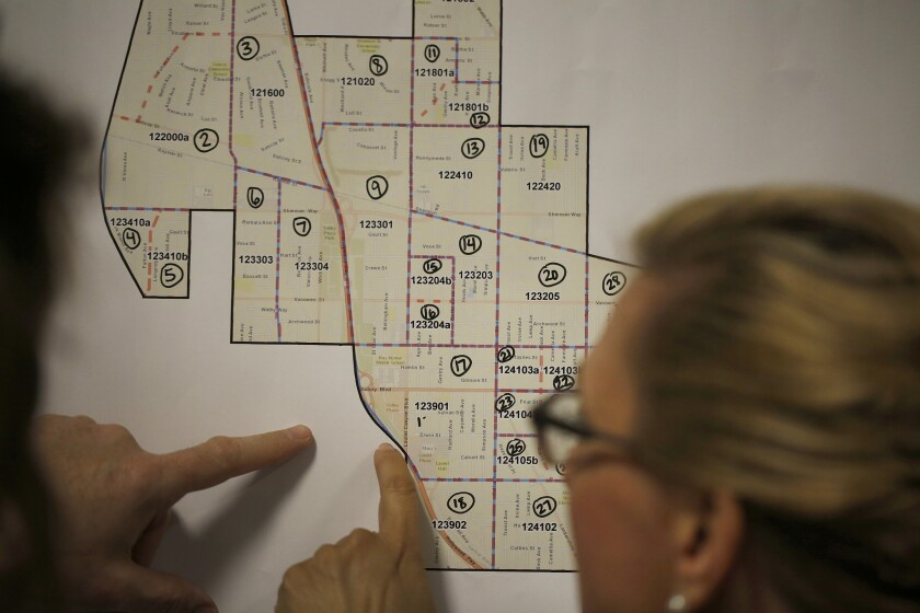 Volunteers study map during homeless count