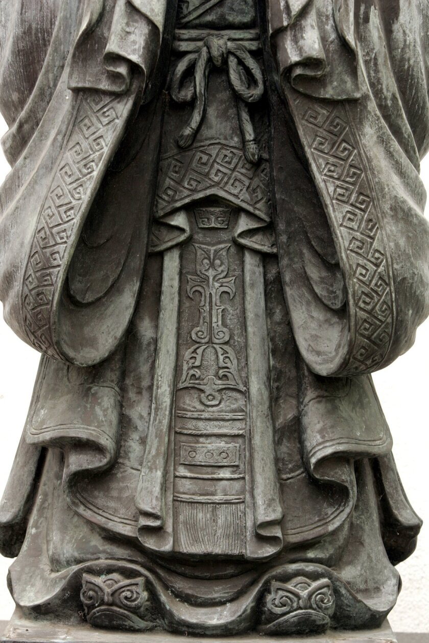 A detail from a sculpture of Confucius at the Chinese Historical Museum, still the primary repository of Chinese culture in the area.