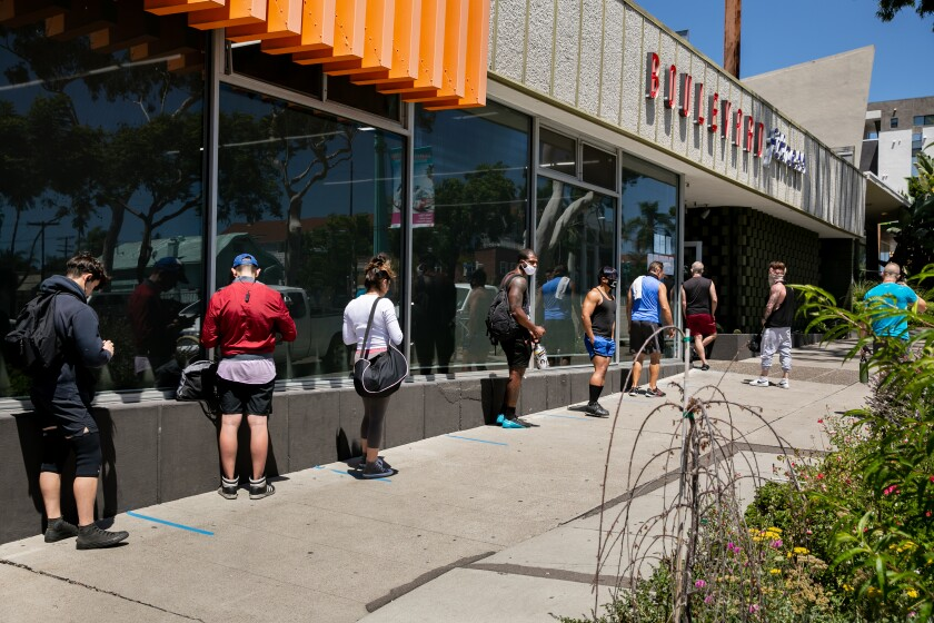 Gym goers line up outside Boulevard Fitness on August 7. The gym remains open even after receiving a closure order.