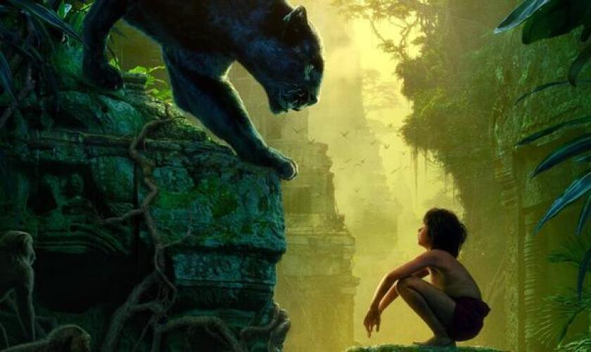 """Characters Bagheera and Mowgli (played by Ben Kingsley and Neel Sethi) in the """"Jungle Book"""" poster for new Disney film."""