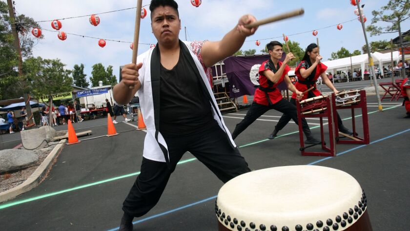 Elaire Andrad performs with the Japanese drumming group called Asayake Taiko Saturday during the Obo