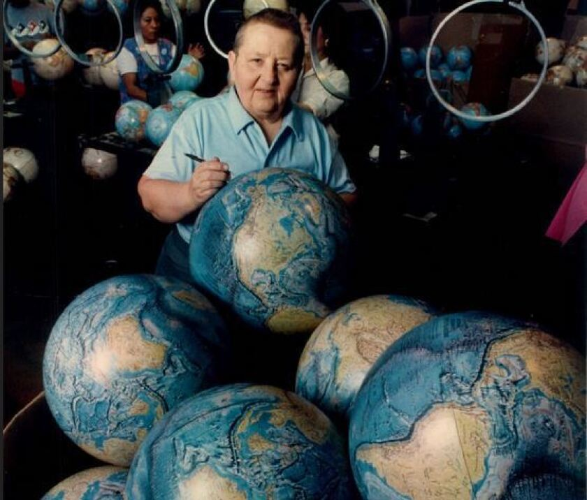 LeRoy M. Tolman shown in 1987 checking over a shipment of globes.