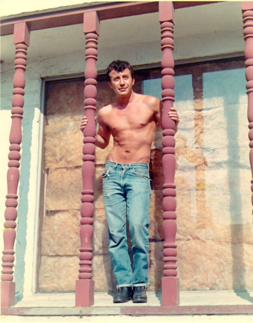 Author John Rechy in a photo from the 70s in Los Angeles. Photo to accompany Susan Straight essay o