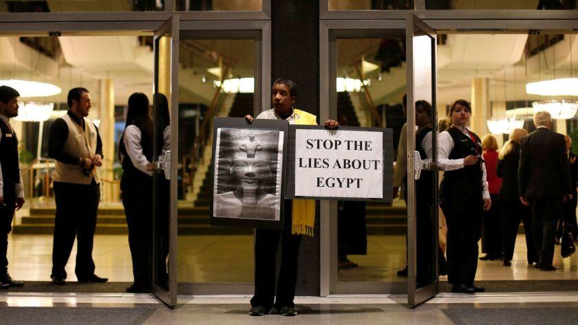 Protester Akosua Pierce outside Dorothy Chandler Pavilion on opening night.