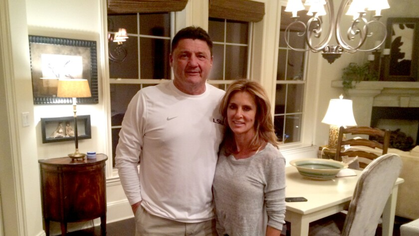 LSU football Coach Ed Orgeron and wife Kelly welcome a reporter to their home on Saturday in Mandeville, La.