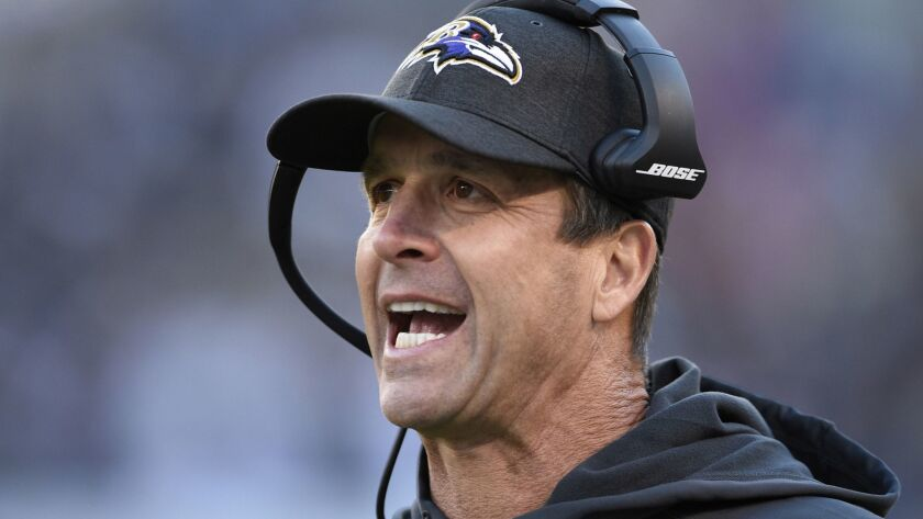 FILE - In this Oct. 21, 2018, file photo, Baltimore Ravens coach John Harbaugh stands on the sidelin