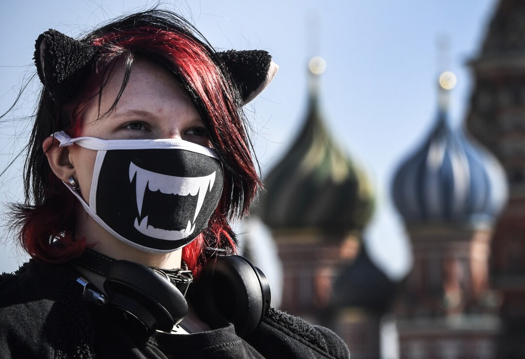 A young woman walks on Red Square in Moscow.