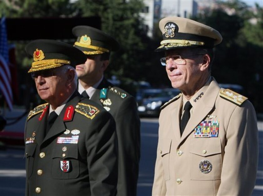 Chairman of the U.S. Joint Chiefs Adm. Mike Mullen, right, and Turkey's Chief of Staff Gen. Isik Kosaner inspect a guard of honour at the Turkish army headquarters in Ankara, Turkey, Friday, Sept. 3, 2010. The United States is seeking Turkish permission to withdraw noncombat military equipment from Iraq through its territory and Turkey is likely to agree to the request, a Turkish Foreign Ministry official said Friday.(AP Photo/Burhan Ozbilici)
