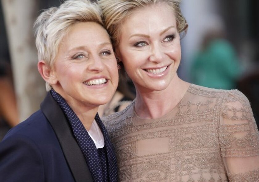Ellen DeGeneres, left,  with wife Portia de Rossi. The couple have made another move in the L.A. real estate market, this time selling a glamorous Hollywood Regency-style home in Beverly Hills for $15.5 million.