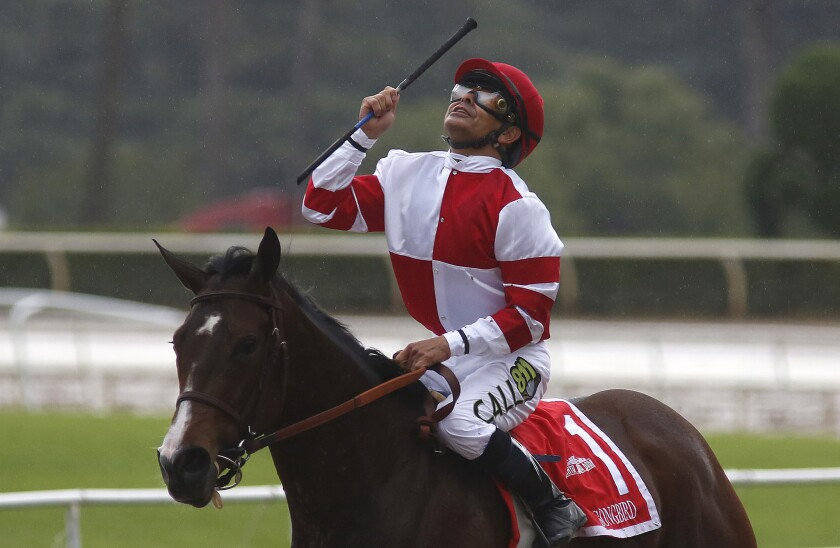 Jockey Mike Smith celebrates after riding Songbird to an easy win in the Santa Anita Oaks on April 9.