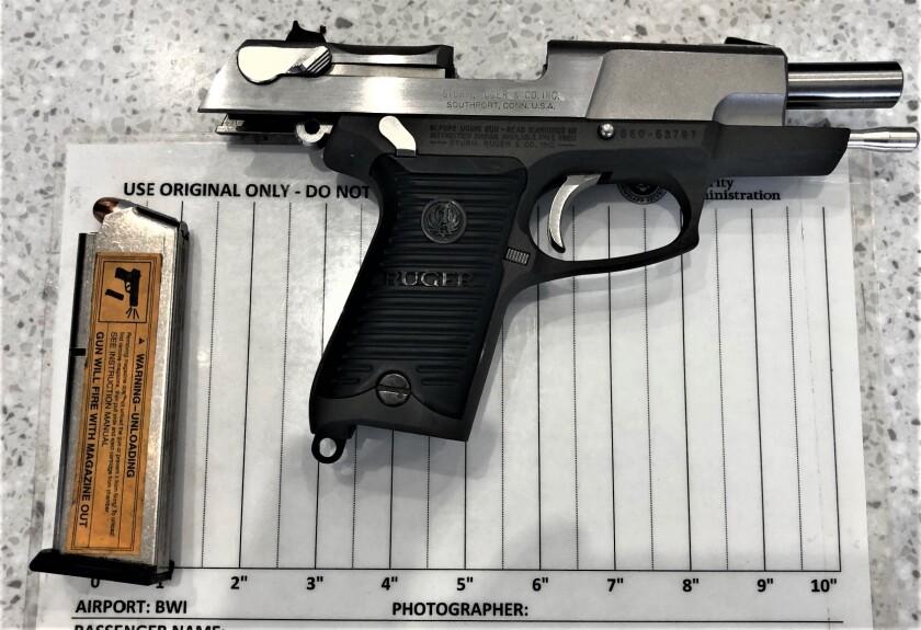 A handgun found in a carry-on bag