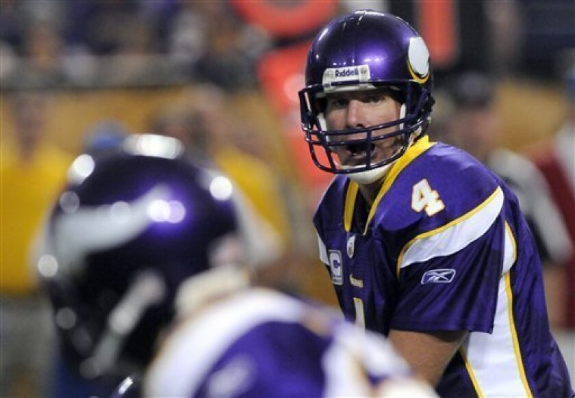 """photo taken on Sunday, Sept. 27, 2009, Minnesota Vikings quarterback Brett Favre shouts out at the line of scrimmage against the San Francisco 49er during an NFL football game in Minneapolis. Favre says he's not out for revenge heading into the Vikings' Monday night game against his former team, a statement that contradicts his previous comments about wanting to """"stick it"""" to the man who traded him, general manager Ted Thompson. (AP Photo/Jim Mone)"""