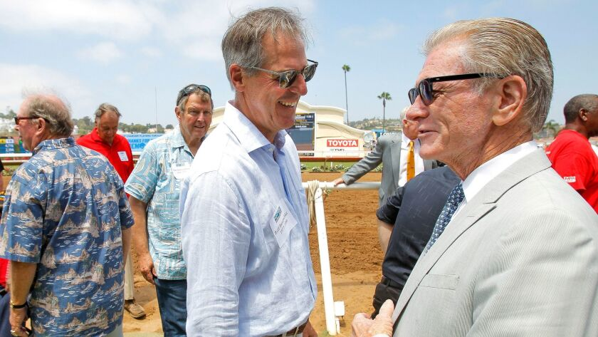 Former Chargers kicker Rolf Benirschke (left) talks to Joe Harper, president and CEO of the Del Mar Thoroughbred Club, during a fan event July 22. Harper, 74, said he plans to remain in his current role.