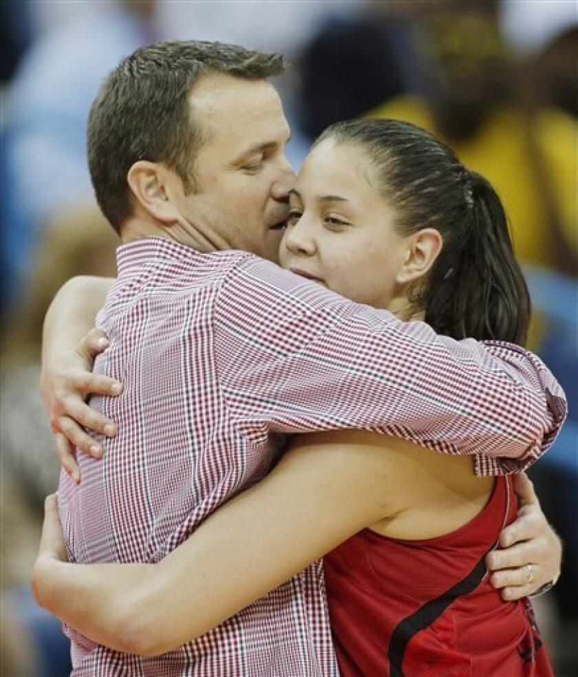 Louisville head coach Jeff Walz hugs Shoni Schimmel (23) after Connecticut defeated Louisville 93-60 in the national championship game of the women's Final Four of the NCAA college basketball tournament, Tuesday, April 9, 2013, in New Orleans. (AP Photo/Dave Martin)