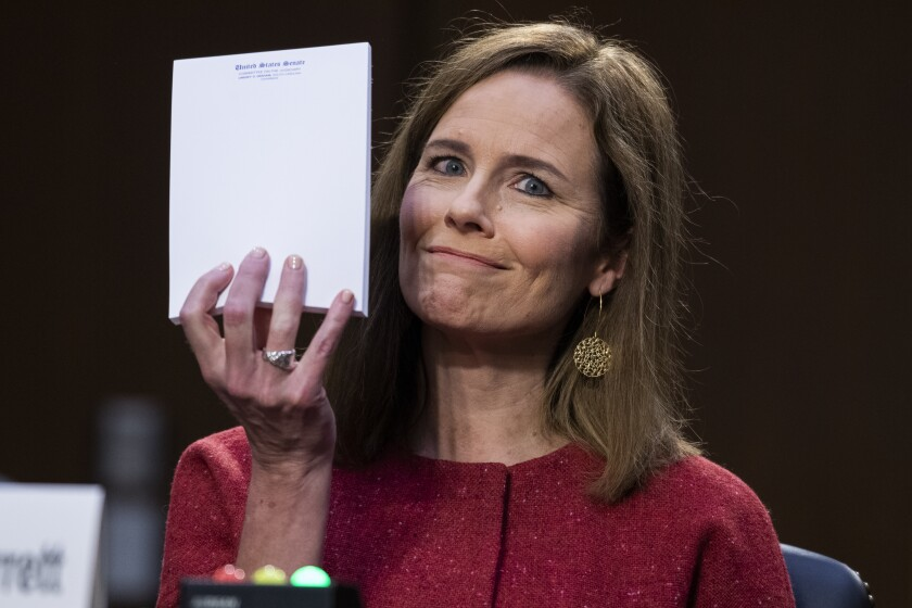 Supreme Court nominee Amy Coney Barrett holds up her notepad as she speaks on the second day of her confirmation hearing.
