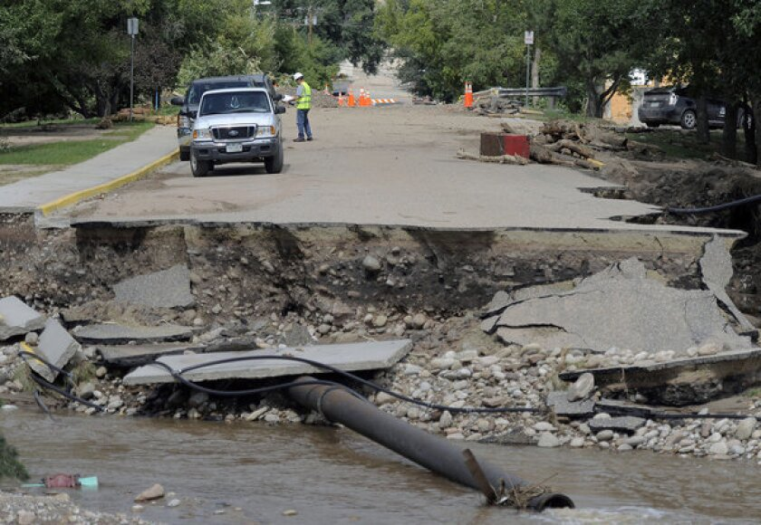 This photo shows a road that was washed out by the flood in Lyons, Colo., on Sept. 19. The recovery process has begun all along the Front Range as people clean out flooded homes and businesses. Local governments are starting to clear debris and repair infrastructure.