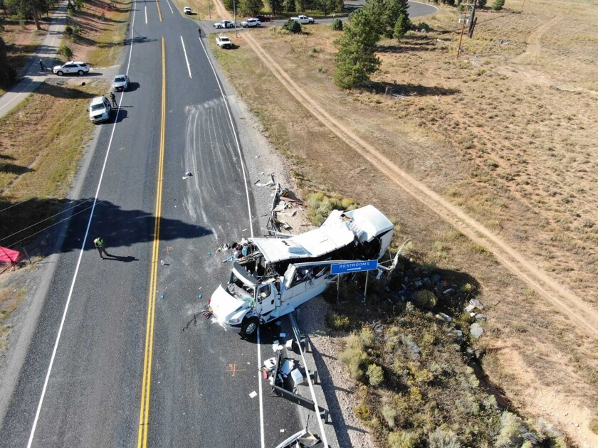 FILE - This photo provided by the Utah Highway Patrol shows a tour bus that crashed near Bryce Canyon National Park in southern Utah on Friday, Sept. 20, 2019. Federal investigators say a tour bus crash that threw more than a dozen people onto a remote Utah highway in 2019 and killed four Chinese tourists highlights a lack of safety standards for bus roofs and windows. The National Transportation Safety Board released its final report on the crash Thursday, June 3, 2021. (Utah Highway Patrol via AP, File)