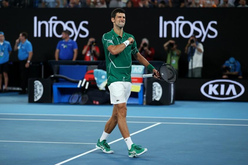 Novak Djokovic celebrates Jan. 30 after defeating Roger Federer in an Australian Open semifinal.