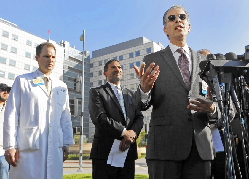 UCLA defended its new cleaning protocol and said no new infections have occurred since making the change. Above, Dr. David Feinberg, right, president of the UCLA Health System, takes questions during a press conference last week. With him are Dr. Zachary Rubin, left, UCLA's medical director of clinical epidemiology and infection prevention, and Robert Cherry, chief medical and quality officer at UCLA Health System