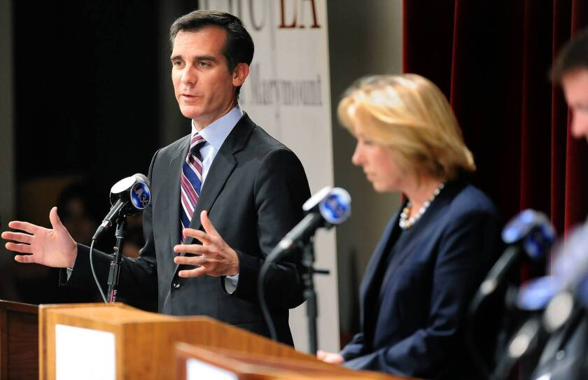Eric Garcetti answers a question during a candidates debate at Loyola Marymount University last week. Supporters are launching an independent campaign to spend money on his behalf in an effort to level the playing field with his chief rival, Wendy Greuel.