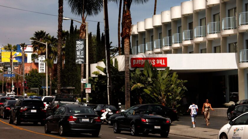 HOLLYWOOD, CA - MAY 3, 2014 -- Pedestrians and traffic pass in front of The Standard Hotel on Sunset