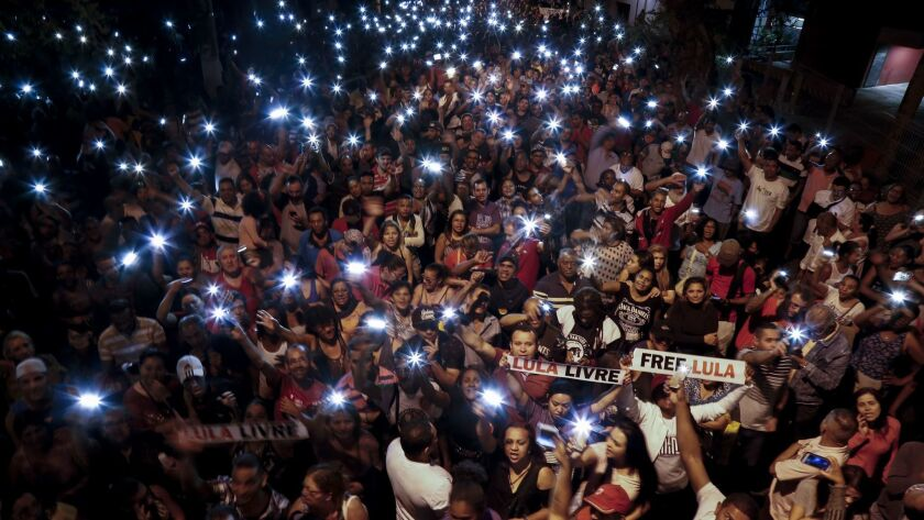 Supporters of former Brazilian President Luiz Inacio Lula da Silva, who has been in jail since April for corruption, demonstrate in Sao Paulo, calling for him to be freed.