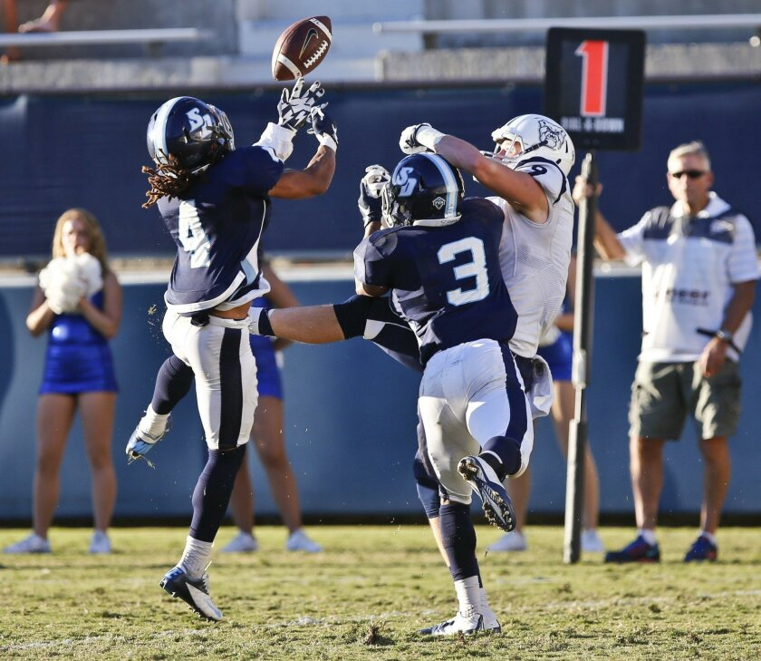 USD's Yogi Hale (left) intercepts this pass intended for Butler's Brandon Collins on a two-point play after Butler's late fourth quarter touchdown at Torero Stadium on Saturday. USD won the game 28-27. Photo by Don Boomer