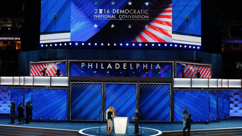 Workers put final touches on the podium as preparations are made for the Democratic National Convention, at the Wells Fargo Center in Philadelphia, Pennsylvania.