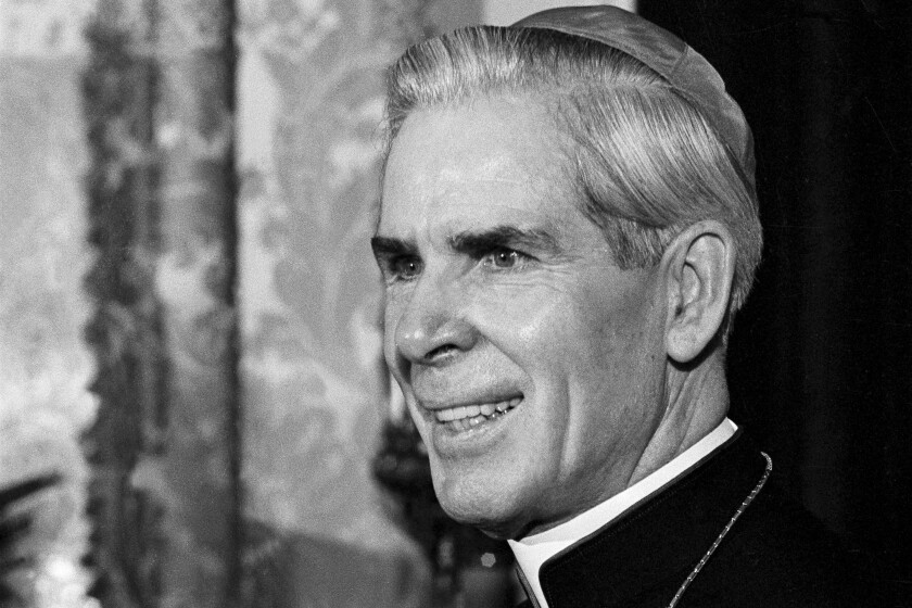 FILE - This Oct. 26, 1966 file photo shows Bishop Fulton J. Sheen in his office at the Propagation of Faith in New York. Sheen, who before his death in 1979 was famous for his radio and TV preaching, had been scheduled to be beatified _ the last step before sainthood _ in a ceremony in Peoria on Dec. 21, 2019. However, the Vatican recently took the rare step of indefinitely postponing the ceremony at the request of the Rochester diocese, which said more time was needed for further investigations. (AP Photo/Eddie Adams)
