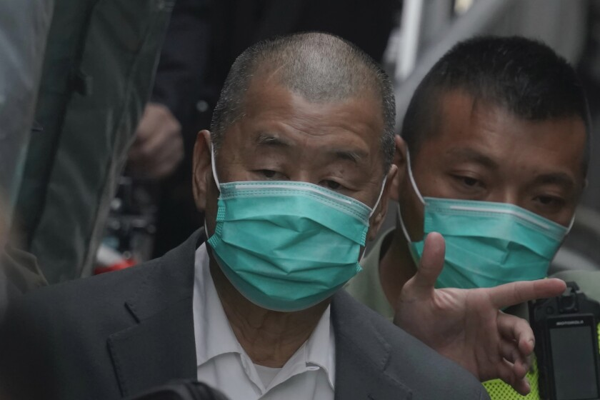 Democracy advocate Jimmy Lai leaves the Hong Kong's Court of Final Appeal where the government is arguing against allowing him bail in Hong Kong Tuesday, Feb. 9, 2021. Hong Kong's Court of Final Appeal denied bail Tuesday for prominent democracy advocate and newspaper founder Lai, upholding the government prosecution's appeal. (AP Photo/Kin Cheung)
