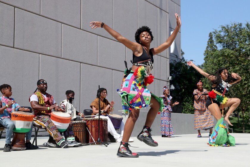 """Members of the Dembrebrah Drum and Dance Ensemble perform during """"Freedom in Full Bloom: a Juneteenth Celebration."""""""