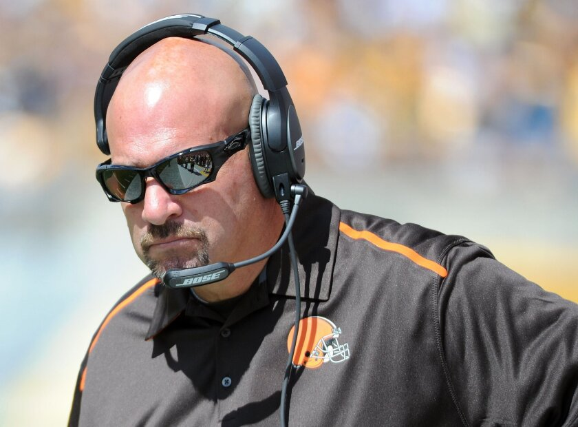 Cleveland Browns head coach Mike Pettine walks the sideline in the second quarter of an NFL football game against the Pittsburgh Steelers, Sunday, Sept. 7, 2014, in Pittsburgh. (AP Photo/Don Wright)