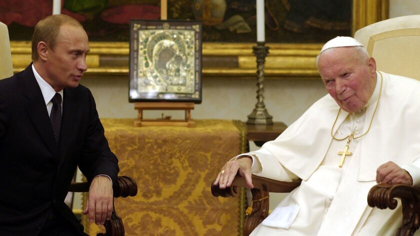 Russian President Vladmir Putin meets with Pope John Paul II at the Vatican on Nov. 5, 2003.