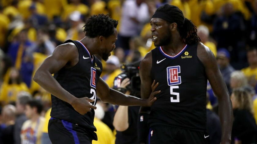 Patrick Beverley, left, and Montrezl Harrell of the Clippers celebrate after they beat the Golden State Warriors during Game 2 of the first round of the NBA Western Conference Playoffs.