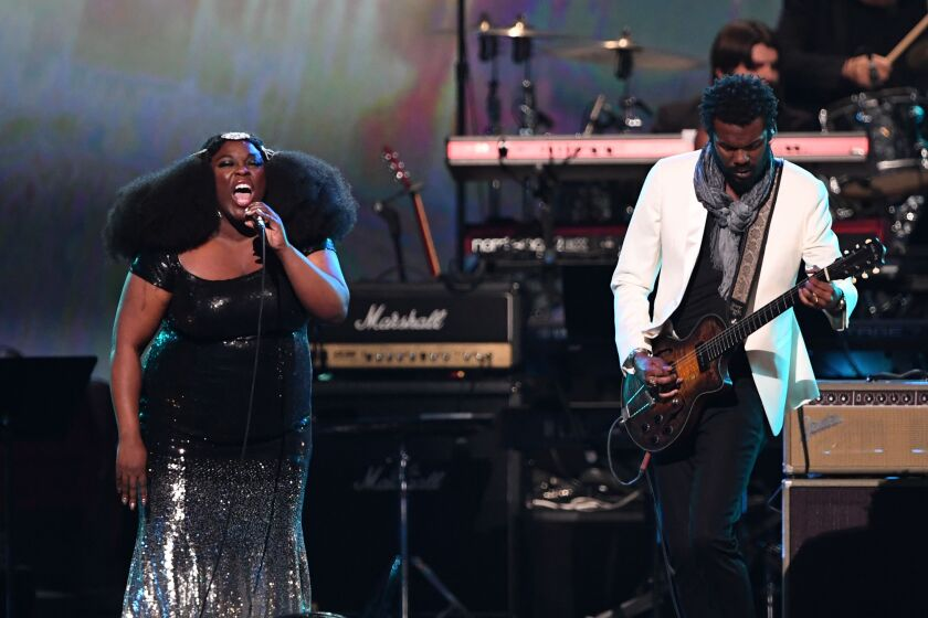 Yola (left) and Gary Clark Jr. are shown performing at the 2020 MusiCares Person Of The Year gala concert honoring Aerosmith at the Los Angeles Convention Center.