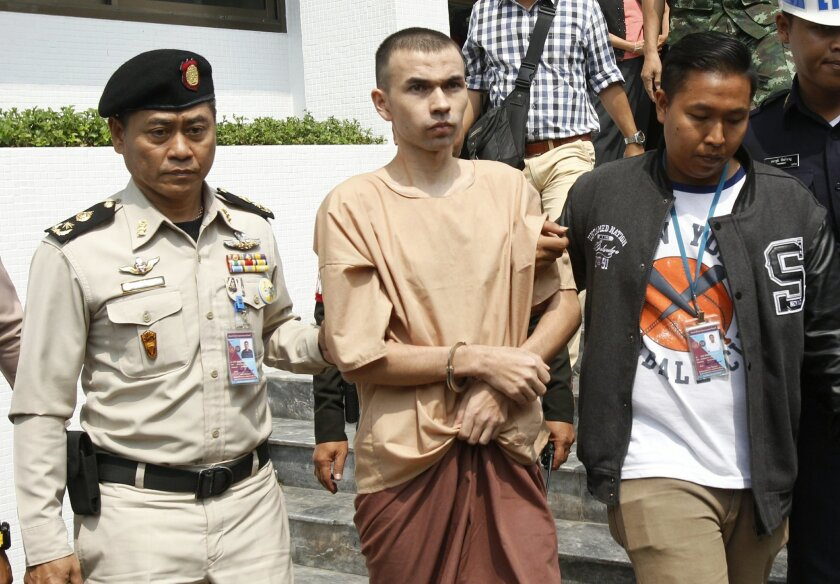 Thai correctional officers escort Bilal Mohammad, center, from a military court in Bangkok, Thailand, Tuesday, Feb. 16, 2016. Two foreigners, including Bilal, accused of carrying out a deadly bombing of a Bangkok landmark last year were brought to the military court Tuesday for the start of a highl