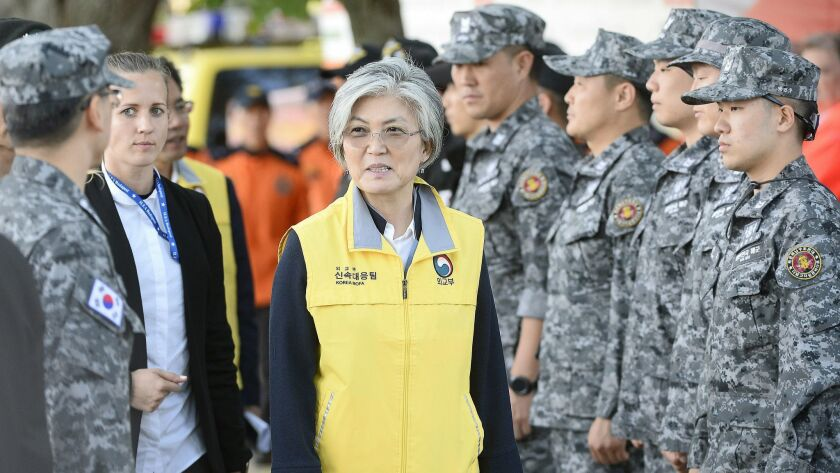South Korean Foreign Minister Kang Kyung-wha, center, meets members of a South Korean rescue team pa